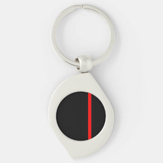 La ligne rouge mince symbolique sur un décor noir porte-clés