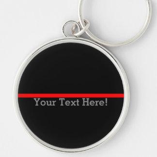 La ligne rouge mince symbolique votre texte sur le porte-clés