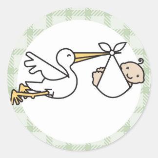 La livraison de bébé de cigogne sticker rond