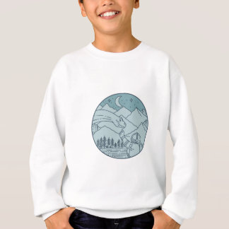 La lune de brontosaure d'astronaute tient le sweatshirt