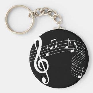 La musique coule blanc sur le porte - clé noir porte-clé rond