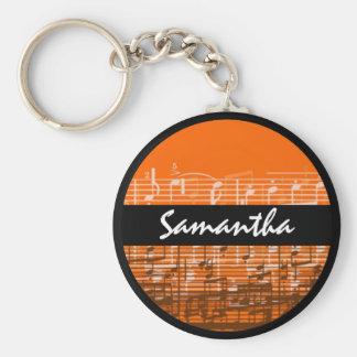 La musique orange lumineuse note le porte - clé porte-clés