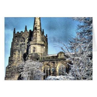 La neige a couvert l'église carte de vœux