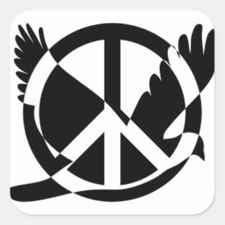 La paix a plongé dans le signe de paix sticker carré