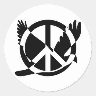 La paix a plongé dans le signe de paix sticker rond