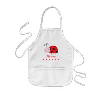 La petite coccinelle rouge personnalisée badine le tablier enfant
