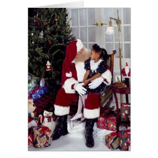 La petite fille donne à Père Noël un Wishlist Carte De Vœux
