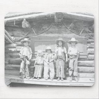 La photo de ranch de type des enfants dans le cowb tapis de souris