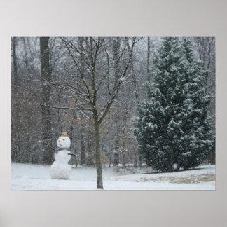 La photographie de neige d'hiver du bonhomme de posters