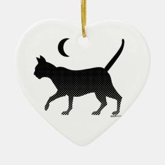 La silhouette d'un chat sous la lune ornement cœur en céramique