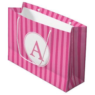La sucrerie rose décorée d'un monogramme barre le grand sac cadeau