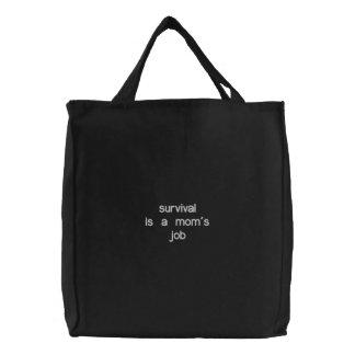 La survie est le travail d'une maman - sac brodé