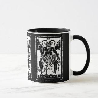 La tasse de café de carte de diable