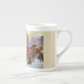 La tasse de porcelaine tendre d'entraîneur de Noël
