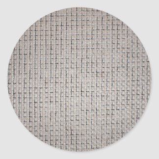La texture du tissu gris sticker rond