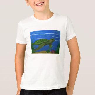 La tortue badine le T-shirt