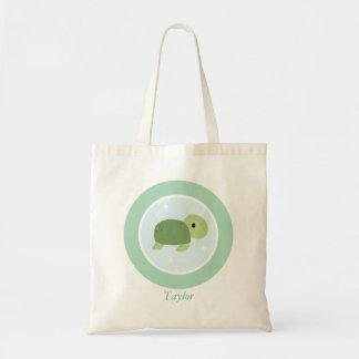 La tortue de mer mignonne badine le sac