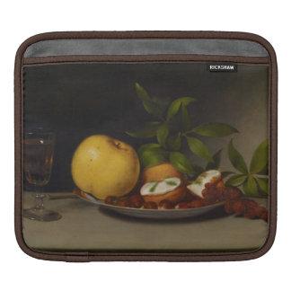 La vie toujours avec le fruit, les gâteaux et le poches pour iPad