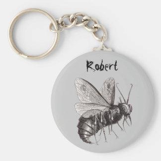 L'abeille personnalisée avec le crâne s'envole le porte-clé rond