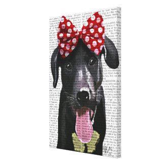 Labrador noir avec l'arc rouge sur la tête toile