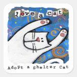 L'amour, adoptent des chats d'abri adhésif