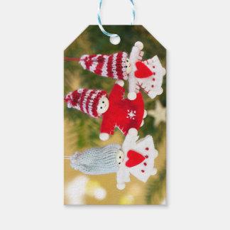 L'ange de Noël ornemente des étiquettes de cadeau