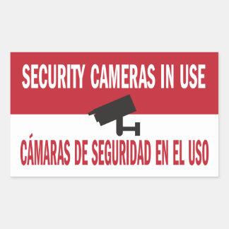 L'anglais espagnol bilingue de caméras de sécurité sticker rectangulaire