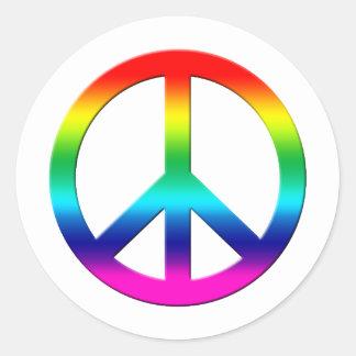 L'arc-en-ciel colore le signe de paix sticker rond