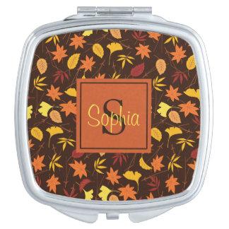 L'automne de jaune orange laisse à monogramme le miroir de voyage