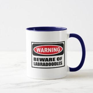 L'avertissement PRENNENT GARDE de la tasse de