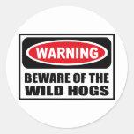 L'avertissement PRENNENT GARDE de l'autocollant