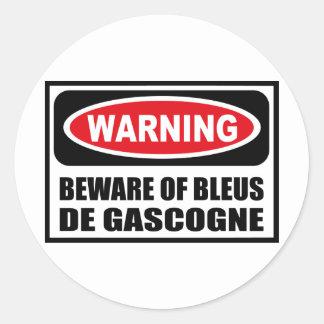 L'avertissement PRENNENT GARDE de l'autocollant de