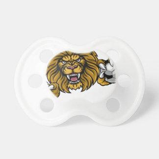 Le ballon de football de lion folâtre la mascotte tétine