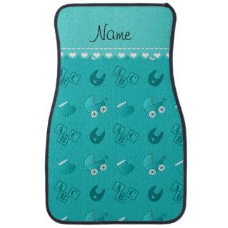 Le bavoir nommé de bébé de turquoise bloque des tapis de sol