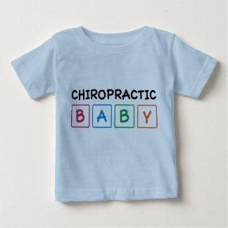 Le bébé de chiropractie bloque le T-shirt