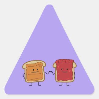 Le beurre d'arachide et le poing de gelée cognent sticker triangulaire