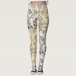 Le blanc créatif et l'or ont conçu des guêtres leggings