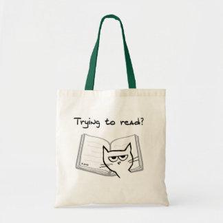 Le chat fâché défie des amoureux des livres sacs de toile