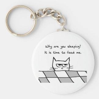 Le chat fâché vous veut hors du lit porte-clé rond