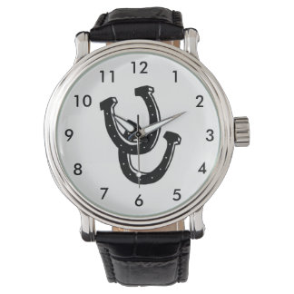 Le cheval chausse la montre de maréchal-ferrant de montres