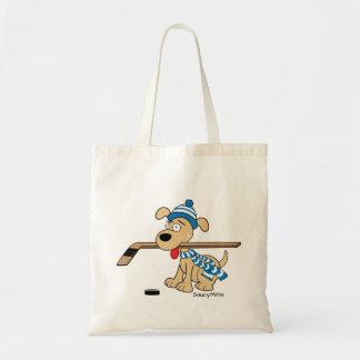 Le chien mignon d'hockey badine le bleu de la sac