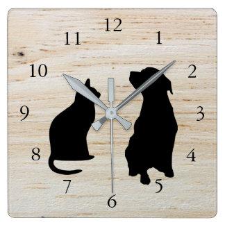 Le chien moderne de chat silhouette l'arrière - horloge carrée