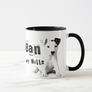 Le chiot d'interdiction fraise la tasse de droits