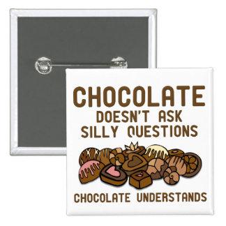 Le chocolat comprend l'insigne drôle de bouton badges