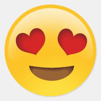 le coeur observe des autocollants d'emoji