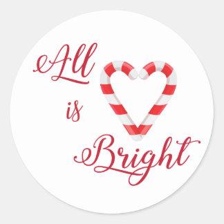 Le coeur tout de sucre de canne est lumineux sticker rond
