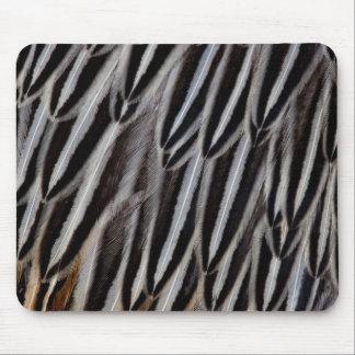 Le coq de jungle fait varier le pas du plan tapis de souris