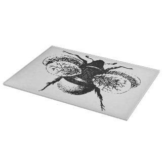 Le cru gaffent l abeille planche à trancher