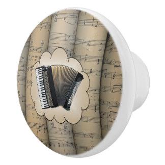 Le ~ de nuage de ~ d'accordéon a roulé la musique bouton de porte en céramique