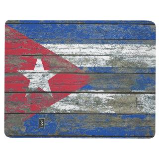 Le drapeau cubain sur le bois rugueux embarque carnet de poche